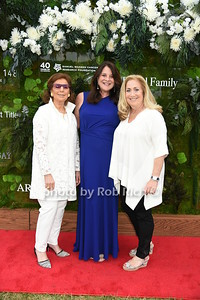 "Marion Waxman, Karen  Amster -Young, and Laurie Schaffran attend the Samuel Waman Cancer Research Foundation 12th.Annual ""A Hamptons Happening"" at the private residence of Ken and Maria Fishel in Bridgehamton on July 9, 2016."