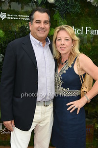 """Charles Regensberg and Regina Quinan attend the Samuel Waman Cancer Research Foundation 12th.Annual """"A Hamptons Happening"""" at the private residence of Ken and Maria Fishel in Bridgehamton on July 9, 2016."""