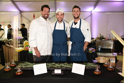 "Paul Michael, Greg Grossman and Jake Geragos from Oreya restaurant attend the Samuel Waman Cancer Research Foundation 12th.Annual ""A Hamptons Happening"" at the private residence of Ken and Maria Fishel in Bridgehamton on July 9, 2016."