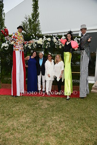 """Karen  Amster -Young,Dr.Samuel Waxman, Marion Waxman,  and Laurie Schaffran pose with performers at  the Samuel Waman Cancer Research Foundation 12th.Annual """"A Hamptons Happening"""" at the private residence of Ken and Maria Fishel in Bridgehamton on July 9, 2016."""