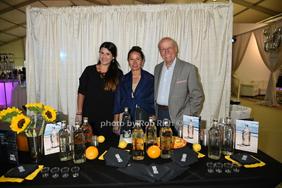 """Diana Vivas, Sara Kiembock, and Berhnard Kiembock attend the Samuel Waman Cancer Research Foundation 12th.Annual """"A Hamptons Happening"""" at the private residence of Ken and Maria Fishel in Bridgehamton on July 9, 2016."""