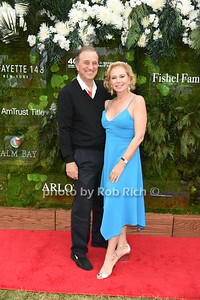 """Michael Trokel and Pamela Morgan attend the Samuel Waman Cancer Research Foundation 12th.Annual """"A Hamptons Happening"""" at the private residence of Ken and Maria Fishel in Bridgehamton on July 9, 2016."""