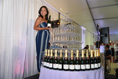 """Chantelle Pabros and the Tattinger wine tower ready to be filled with champagne at the Samuel Waman Cancer Research Foundation 12th.Annual """"A Hamptons Happening"""" at the private residence of Ken and Maria Fishel in Bridgehamton on July 9, 2016."""