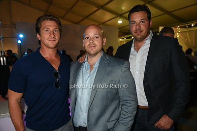 "Cody Vichinski, Mike Cantwell, and Sam Kelly attend the Samuel Waman Cancer Research Foundation 12th.Annual ""A Hamptons Happening"" at the private residence of Ken and Maria Fishel in Bridgehamton on July 9, 2016."