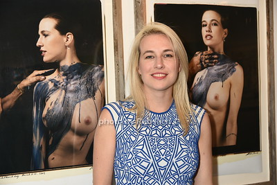Natalie White poses in front of one of her images shot by photographer Peter Beard photo by Rob Rich/SocietyAllure.com © 2016 robwayne1@aol.com 516-676-3939