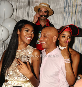 "Russell Simmons, joined by a bevy of beauties (and DJ Cassidy in the backgroung) at the after party for his ""Art for Life Benefit"" at AM niteclub in Southampton. photo by Rob Rich/SocietyAllure.com © 2016 robwayne1@aol.com 516-676-3939"