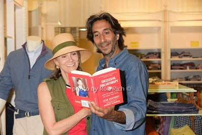 Victoria Elenowitz and  Jacques Azoulay reading Jean Shafiroff's book on philantrophy