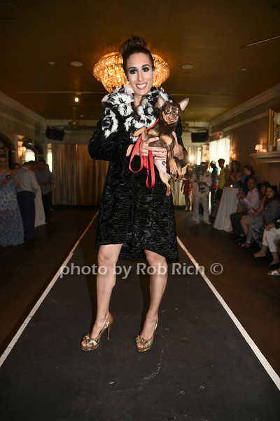 Nicole Teitler and dog for adoption walk the runway at the Catwalk for Canines ethical & eco fashion show to benefit the Southampton Animal foundation at the Southampton Social Club in Southampton on Saturday, June 10, 2017.