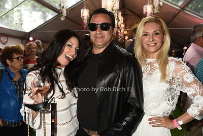Stacy Weisser, Seth Weisser, and Lydiane Interdonato attend Dan's Rose' Soiree at the Southampton Arts Center in Southampon on May 28, 2017.