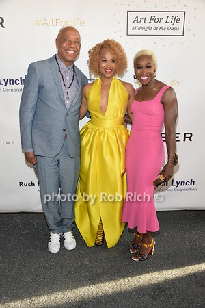 Russell Simmons, Esi Eggleston Bracey and Cynthiua Ervio attend Russell Simmons Rush Philanthropic Arts Foundation Annual Art for Life Benefit  at Fairview Farms in Watermill on Saturday, July 15, 2017. attend Russell Simmons Rush Philanthropic Arts Foundation Annual Art for Life Benefit  at Fairview Farms in Watermill on Saturday, July 15, 2017. photo by Rob Rich/SocietyAllure.com ©2017 robrich101@gmail.com 516-676-3939