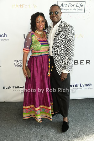 Artist Sanford Bigggers and wife attend Russell Simmons Rush Philanthropic Arts Foundation Annual Art for Life Benefit  at Fairview Farms in Watermill on Saturday, July 15, 2017. photo by Rob Rich/SocietyAllure.com ©2017 robrich101@gmail.com 516-676-3939