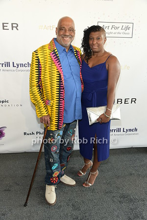 Danny Simmons and Teia Simmons attend Russell Simmons Rush Philanthropic Arts Foundation Annual Art for Life Benefit  at Fairview Farms in Watermill on Saturday, July 15, 2017. photo by Rob Rich/SocietyAllure.com ©2017 robrich101@gmail.com 516-676-3939