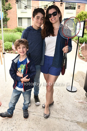 Alexander Nersesyan, Robert Nersesyan and  Yelena Nersesyan attend the Southampton Inn's annual Memorial Day party in Southampton on May 28, 2017.