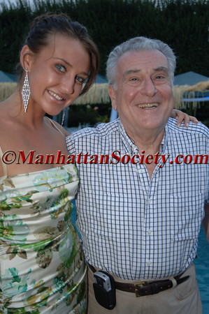 "WATERMILL, NEW YORK-AUGUST 13: Anna Anisimova & Dr. Robert Cancro attend Young Friends of MIPC Annual Summer Bash ""Hawaii 5-0""  to Benefit Dr. Robert Cancro and the Mental Illness Prevention Center of NYU at 33 Mill Creek Close, Watermill, New York on Saturday. August 13, 2005 (Photo Credit: Gregory Partanio/ManhattanSociety.com)"
