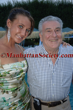 """Anna Anisimova & Dr. Robert Cancro WATERMILL, NEW YORK-AUGUST 13: Guests attend Young Friends of MIPC Annual Summer Bash """"Hawaii 5-0""""  to Benefit Dr. Robert Cancro and the Mental Illness Prevention Center of NYU at 33 Mill Creek Close, Watermill, New York on Saturday. August 13, 2005 (Photo Credit: Gregory Partanio/ManhattanSociety.com)"""