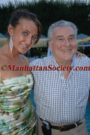 """WATERMILL, NEW YORK-AUGUST 13: Anna Anisimova & Dr. Robert Cancro  attend Young Friends of MIPC Annual Summer Bash """"Hawaii 5-0""""  to Benefit Dr. Robert Cancro and the Mental Illness Prevention Center of NYU at 33 Mill Creek Close, Watermill, New York on Saturday. August 13, 2005 (Photo Credit: Gregory Partanio/ManhattanSociety.com)"""