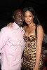 Djimon Honsou and Kimora Lee Simmons attend the Art for Life benefit at the home of Russell Simmons (July 30, 2011)