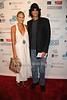 Beth Ostrosky and Howard Stern attend  the Hamptons Rocks for Charity concert at East Hampton Studio (September 1, 2011)