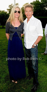 Marci Klein and father Calvin Klein  attend the Midsummer Night Drinks to Benefit God's love We Deliver at the home of Jeff Pfeifle, (May 29,2011)
