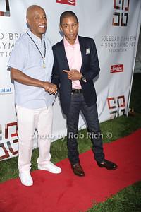 Russell Simmons, Pharrell Williams photo by Rob Rich © 2011 robwayne1@aol.com 516-676-3939