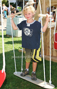 Mason Derosa-Playing on the swings at  the opening day of the Hampton Classic Horseshow (August 31, 2011)