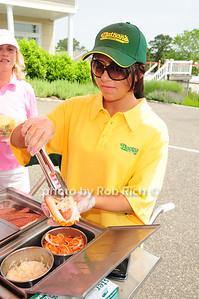 serving a Nathan's hotdog photo by Rob Rich © 2011 robwayne1@aol.com 516-676-3939