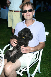 Southampton- July 12:(l-r)   Chris Arnold, Coco  attend the Poolside Lawn party at the Southampton Inn on Sunday, July 12, 2009.    (photo by Rob Rich/SocietyAllure.com)