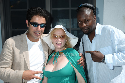Southampton- July 12:(l-r)  Sidi Delqaid, Liz Derringer, DJ Derrick Reason  attend the Poolside Lawn party at the Southampton Inn on Sunday, July 12, 2009.    (photo by Rob Rich/SocietyAllure.com)