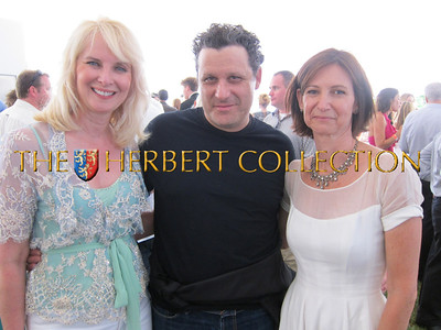 Sara Herbert Galloway, Isaac Mizrahi and Toni Ross at the 2011 Great Chefs Dinner, for the Hayground School's Jeff's Kitchen and  Jeff Salaway Scholarship Fund, at the Hayground School grounds, Sunday evening, July 31, in Bridgehampton. Photo courtesy of Lee Fryd
