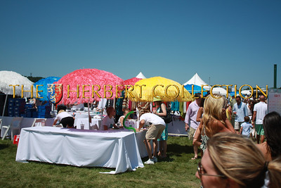 Colorful umbrellas adorn the booths set up in the field, allow for a bit of shade and shelter from the sun