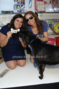 Dr.Cindy Bressler shares a doggie cookie from her Hamptons Cookie Collection with Jersey, who was a dog rescued by Dylan Lauren photo by Rob Rich/SocietyAllure.com © 2013 robwayne1@aol.com 516-676-3939
