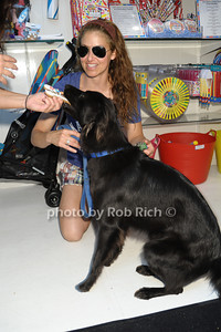 Dylan Lauren shares a doggie cookie from the Hamptons Cookie Collection with her dog Jersey photo by Rob Rich/SocietyAllure.com © 2013 robwayne1@aol.com 516-676-3939