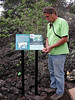 Keoki overseeing signage installation of this outdoor sign in a dryland forest on the Big Island.