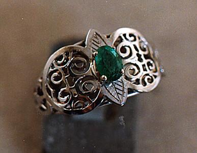 Platinum emerald hand fabricated ring.