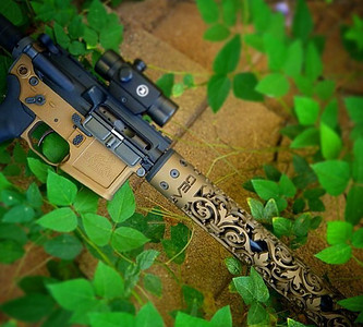 Fleur D Lis hand gaurd in Cerakote Burnt Bronze / Photo of Sandi's personal rifle