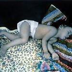 Una Sleeping on Blankets