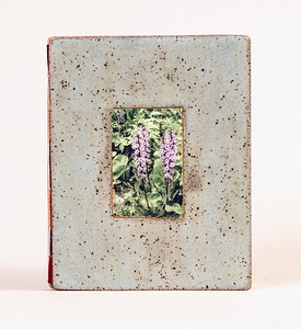 Photography book with handmade ceramic front cover