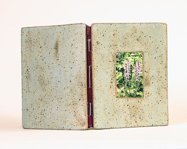 Photography book with handmade ceramic book covers