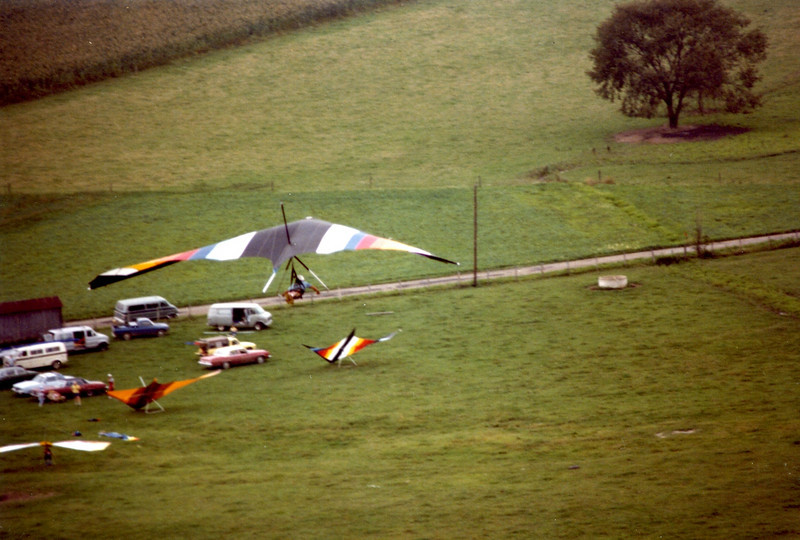 A view from the west facing launch with the landing site below.  At first we had to land before the road, but as the gliders and our ability became better, we had to fly over the power lines along the roadway.