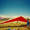 1990 U.S. Hang Gliding National Championships - My Backup Glider (Z1) at Cliff Ridge Launch - I crashed my primary glider (also a Z1) landing in a thunderstorm the day before (broke the leading edge and both downtubes) and that night I traded my Wills Wing HP II to another competitor for his backup glider. HP's were easier to sell, and Z1's are easier to fly so we were both happy with the deal. That's not me, that's our team's trusty driver who could find a needle in 18 haystacks packed back-to-back. That's a handy skill to have when you're chasing confused pilots over half the states of Utah and Colorado.
