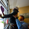 KRISTOPHER RADDER — BRATTLEBORO REFORMER<br /> Grayson Hodgman, 6, a kindergartner at Hinsdale Elementary School, in Hinsdale, N.H., puts hearts up on the window at Brattleboro Memorial Hospital, in Brattleboro, Vt., with help from his father, Bill, on Friday, May 8, 2020. The hearts were part of a class project that required the students to hang up hearts in a visible area for essential workers to see.