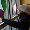 KRISTOPHER RADDER — BRATTLEBORO REFORMER<br /> Grayson Hodgman, 6, a kindergartner at Hinsdale Elementary School, in Hinsdale, N.H., puts hearts up on the window at Brattleboro Memorial Hospital, in Brattleboro, Vt., on Friday, May 8, 2020. The hearts were part of a class project that required the students to hang up hearts in a visible area for essential workers to see.