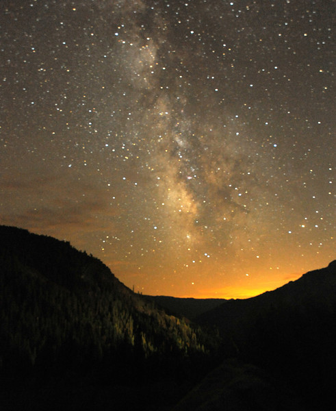 Milky Way Above Forest Fire<br /> <br /> Shot of Milky Way Galaxy above distant light from a forest fire.