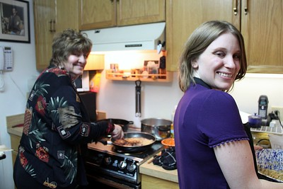 Fay and Kari prepare fresh latkes
