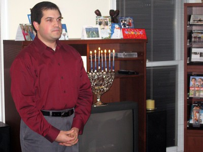 Craig lights the Hanukkiah