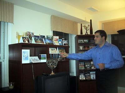 Craig lights the Hanukkiah