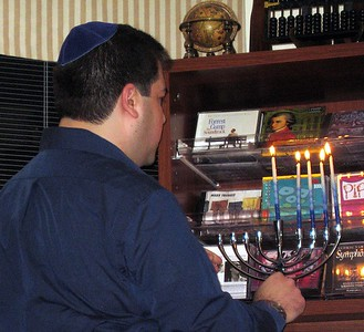 Craig lights the Hanukkah menorah