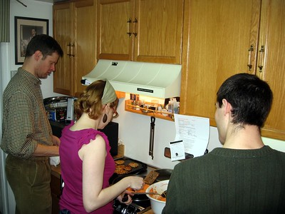William (l), Laura, and Todd prepare fresh latkes