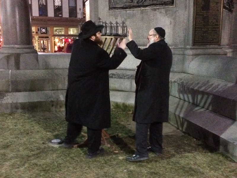 MARK ROBARGE -- MROBARGE@TROYRECORD.COM<br /> The city of Troy recognized Hanukkah on Monday night with a menorah-lighting service in Monument Square.