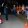 The neighborhood kids. That's Galen in the black holding the scythe. The eyballs & face belong to a kid that's lined up just right...